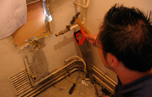 Plumber replacing a boiler.