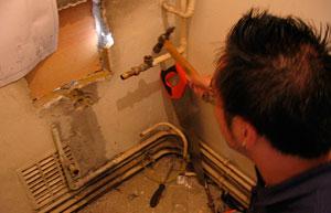 Plumber replacing a boiler.
