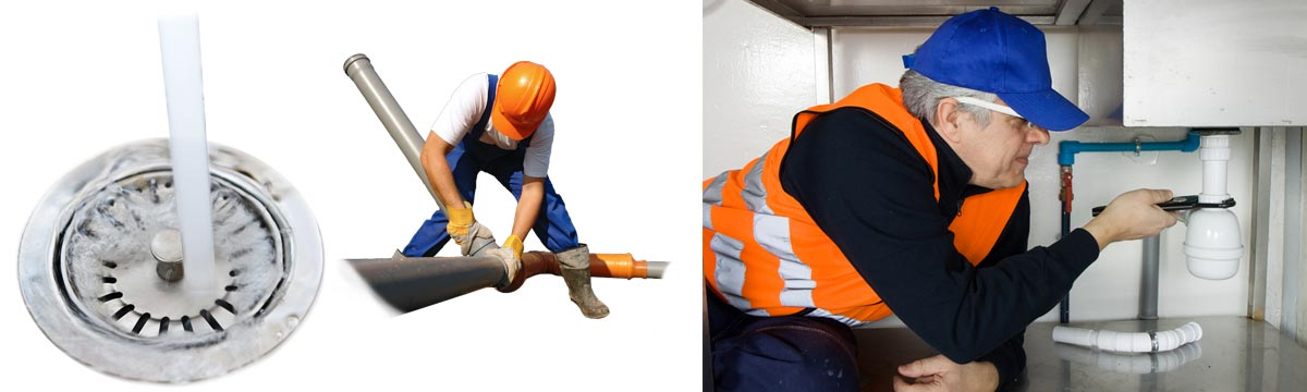Plumbers unblocking a drainage.