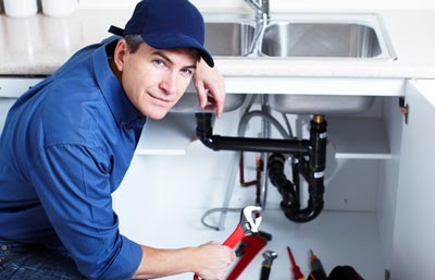 SW16 Plumber replacing a kitchen sink.